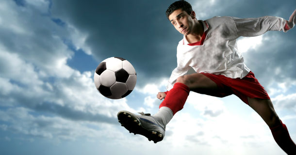 Player kicking soccer ball