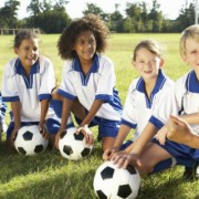 Female Coach cheering soccer players on