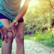 Runner holding knee in pain