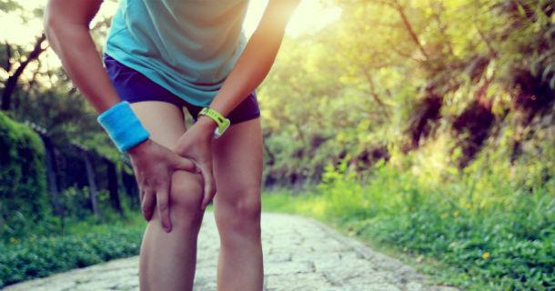 Runner holding knee in pain
