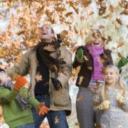 bigstock-Family-Playing-In-Leaves-3914971