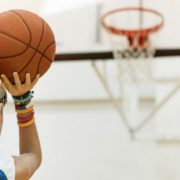 young boy shooting basketball