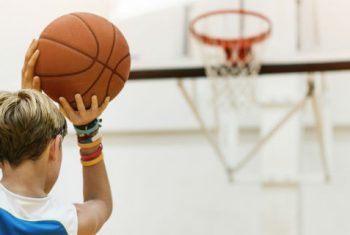 bigstock-Coach-Athlete-Basketball-Bounc-138322094