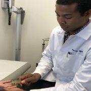 Dr. Daniel Osei analyzing patient