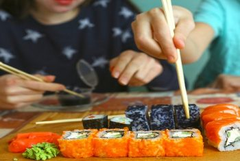 Image - People Eating Sushi