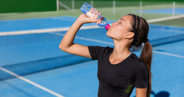 Image - Woman Hydrating on Tennis Court