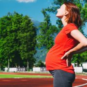 Pregnant Woman on Track Field
