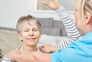 Woman Exercising with Occupational Therapist