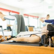 Pilates Instructor Assisting Client