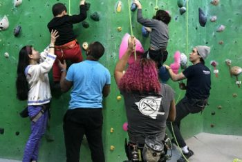 Pediatric Patients Rock Climbing with Instructors
