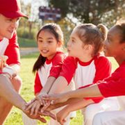 Girl's Baseball Team Kneeling with Coach