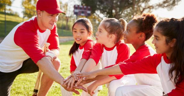 Girl's Baseball Team Kneeling with Coach