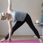 Woman practicing yoga indoors