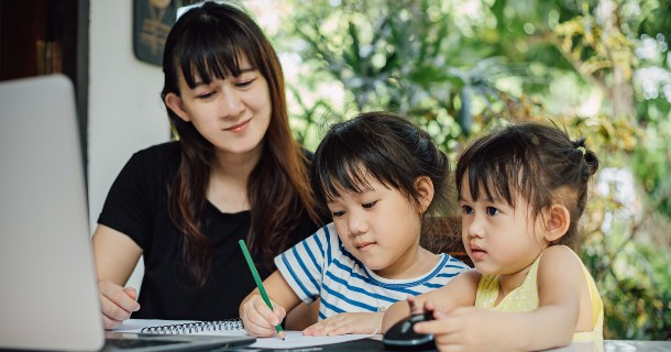 Mom helping children with remote learning