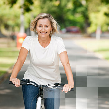 Image - woman riding a bicycle