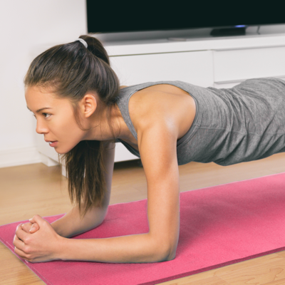 Image of a woman holding plank pose on a yoga mat.